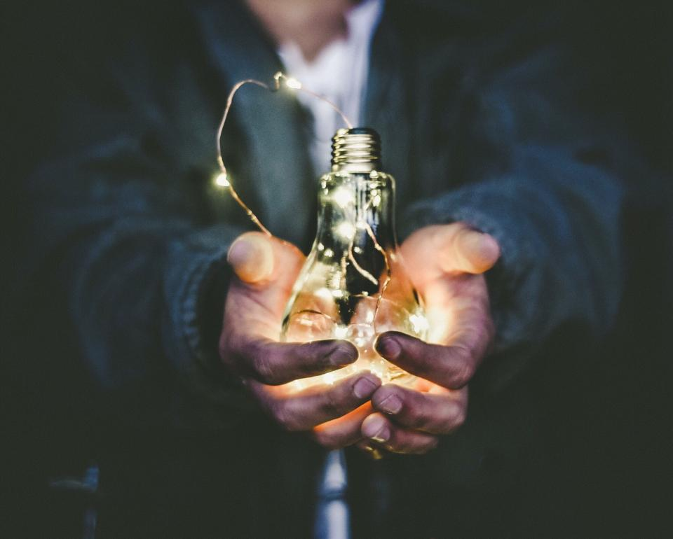 Photo of a light bulb in hands